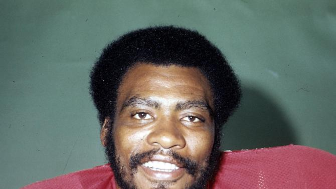 "This 1977 photo provided by the NFL shows Atlanta Falcons football player Claude Humphrey. Humphrey wishes he could have made the Pro Football Hall of Fame ""a long time ago where I could have actually enjoyed it more."""