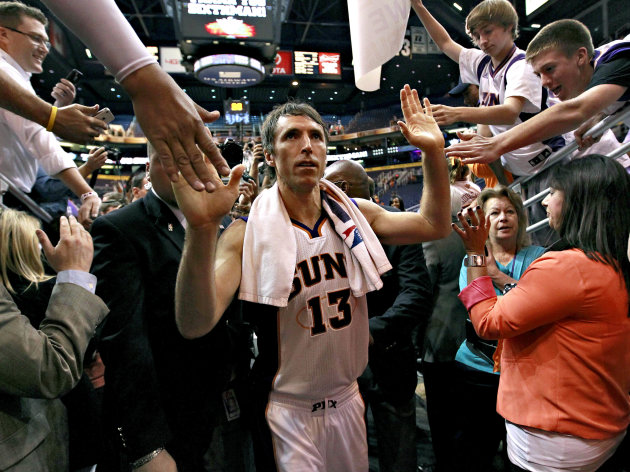 FILE - In this April 25, 2012, file photo, Phoenix Suns&#39; Steve Nash leaves the court after an NBA basketball game against the San Antonio Spurs in Phoenix. Nash&#39;s agent Bill Duffy said Wednesday, July 4, that the two-time MVP point guard is going to the Los Angeles Lakers in a sign-and-trade deal with the Phoenix Suns. (AP Photo/Matt York, File)