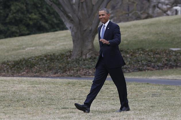 President Barack Obama walks on the South Lawn of the White House in Washington, Tuesday, March 11, 2014, before boarding the Marine One helicopter for a short flight to Andrews Air Force Base, Md., w