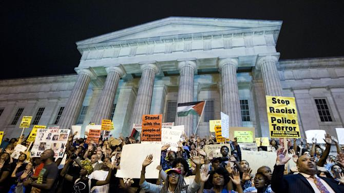 Demonstrators chant at the steps of the National Portrait Gallery in Washington, Saturday, Aug. 23, 2014, during a protest against the shooting of unarmed Michael Brown, a black 18-year-old killed by a white police officer in Ferguson, Mo. (AP Photo/Jose Luis Magana)
