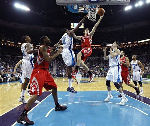 Hornets hurt Rockets' playoff hopes, 105-99 in OT