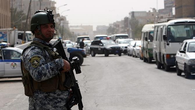 Iraqi security forces set up checkpoints on streets leading to the heavily fortified Green Zone in Baghdad, on March 27, 2012