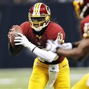 Robert Griffin III scrambles in the first half against the New Orleans Saints. (AP Photo/Gerald Herbert)