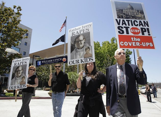 John Lynch, right, father of William Lynch, leads a demonstration outside of a San Jose, Calif., courthouse, Tuesday, July 3,, 2012. William Lynch is accused of attacking an aging priest who Lynch says molested him and his younger brother more than 35 years ago. Lynch faces felony charges of assault and elder abuse. Prosecutors say he beat the Rev. Jerold Lindner at a retirement home for priests in 2010. The jury is deliberating the case. (AP Photo/Paul Sakuma)