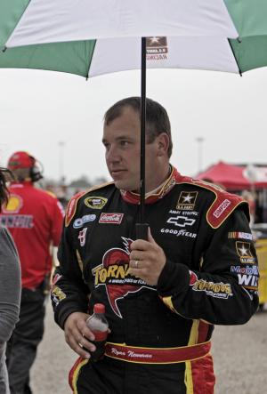 Driver Ryan Newman walks to his trailer during practice for the NASCAR Showtime Southern 500 auto race at Darlington Raceway on Friday, May 6, 2011, in Darlington, S.C.  Practice was canceled due to rain. (AP Photo/Brett Flashnick)