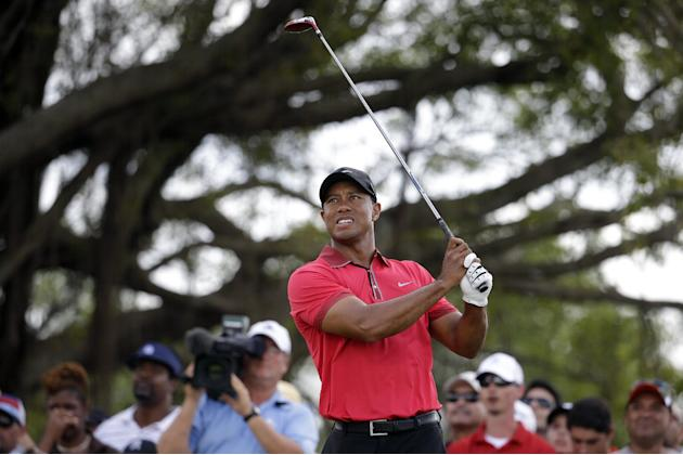 Tiger Woods tees off on the fifth hole during the final round of the Cadillac Championship golf tournament Sunday, March 9, 2014, in Doral, Fla. (AP Photo/Lynne Sladky)