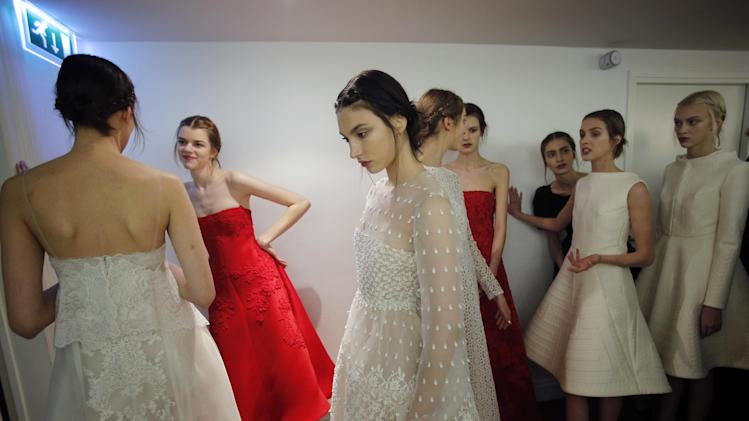 Models wait backstage prior to the Valentino  Spring Summer 2013 Haute Couture fashion collection, presented in Paris, Wednesday, Jan. 23, 2013. (AP Photo/Christophe Ena)
