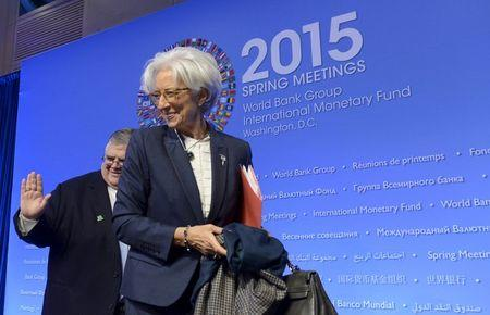 Bank of Mexico Governor Carstens and IMF Managing Director Lagarde prepare to depart after a joint IMFC news conference in Washington