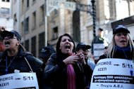 Employees of the Greek Social Security Foundation demonstrate against austerity measures during a protest held outside the Labour Ministry in Athens, on December 7. A Greek operation to buy back some of the country&#39;s huge debt at reduced prices to access additional EU-IMF financial aid has met the 30-billion-euro target set by the authorities, according to news reports