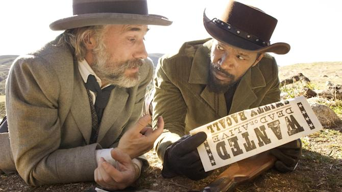 "This undated publicity image released by The Weinstein Company shows, Christoph Waltz as Schultz, left, and Jamie Foxx as Django in the film, ""Django Unchained,"" directed by Quentin Tarantino. Foxx says Hollywood should take some responsibility for tragedies such as the deadly school shooting in Connecticut on Friday, Dec. 14, 2012. In an interview Saturday, Dec. 15, 2012, Foxx said actors cannot ""turn their back"" on that fact that movie violence can ""influence"" people. (AP Photo/The Weinstein Company, Andrew Cooper, SMPSP)"