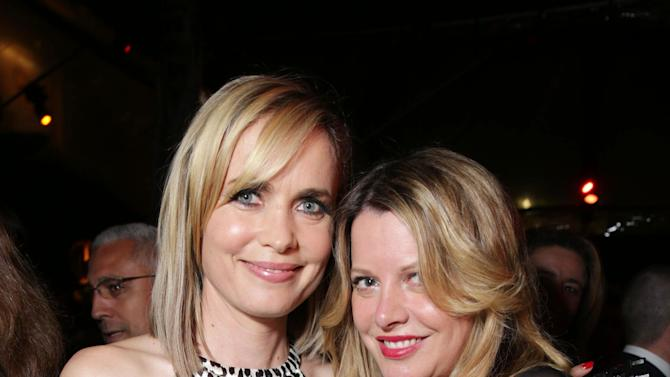 Radha Mitchell and Executive Producer Heidi Jo Markel at FilmDistrict's Premiere of 'Olympus Has Fallen' hosted by Brioni and Grey Goose at the ArcLight Hollywood, on Monday, March, 18, 2013 in Los Angeles. (Photo by Eric Charbonneau/Invision for FilmDistrict/AP Images)