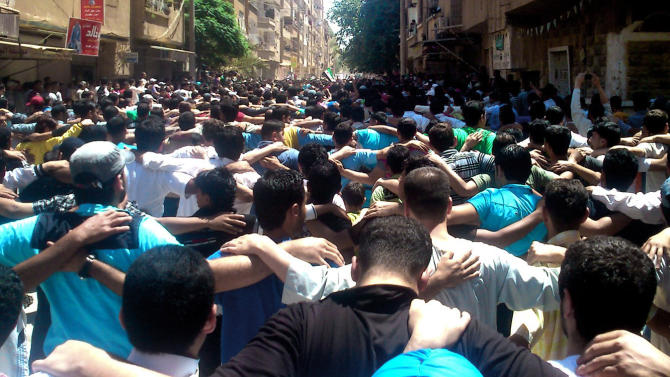 This citizen journalism image provided by Shaam News Network SNN, taken on Friday, June 8, 2012 purports to show a Syrians chanting slogans during a demonstration in the eastern city of Deir el-Zour, Syria. (AP Photo/Shaam News Network, SNN)THE ASSOCIATED PRESS IS UNABLE TO INDEPENDENTLY VERIFY THE AUTHENTICITY, CONTENT, LOCATION OR DATE OF THIS HANDOUT PHOTO