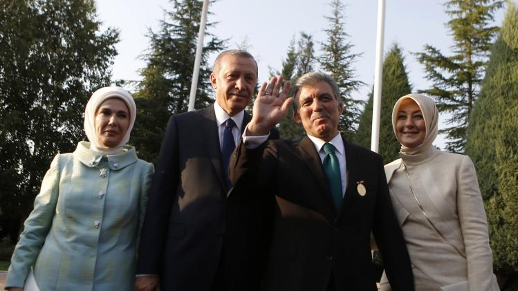 Turkey's new President Tayyip Erdogan and outgoing President Abdullah Gul, accompanied by their wives Emine Erdogan and Hayrunnisa Gul, attend a handover ceremony at Presidential Palace of Cankaya in Ankara