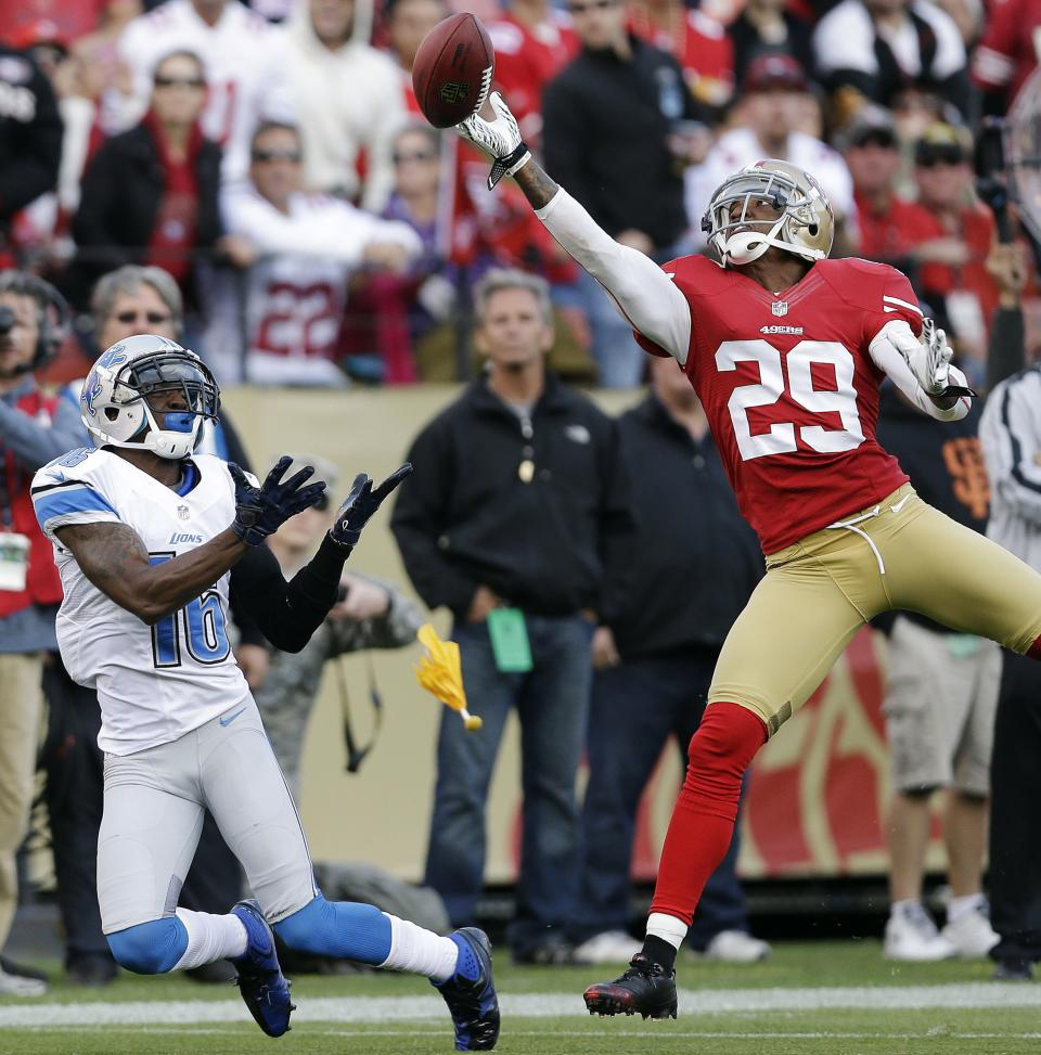 San Francisco 49ers defensive back Chris Culliver, right, breaks up a pass intend for Detroit Lions wide receiver Titus Young, left, during the first quarter of an NFL football game in San Francisco, Sunday, Sept. 16, 2012. A pass interference penalty was called on the play. (AP Photo/Marcio Jose Sanchez)