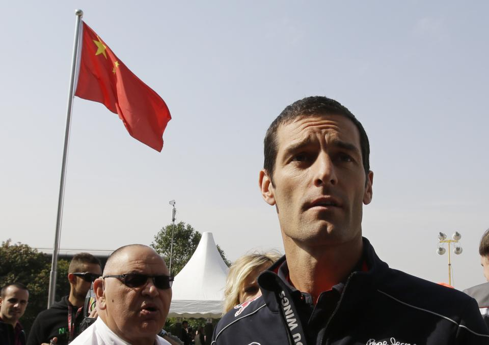 Red Bull driver Mark Webber of Australia walks to the drivers press conference ahead of the Chinese Formula One Grand Prix in Shanghai, China, Thursday, April 11, 2013. (AP Photo/Mark Baker)