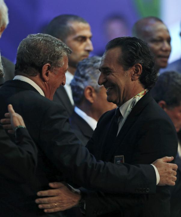 Prandelli chats with England's head coach Hodgson during the draw for the 2014 World Cup in Sao Joao da Mata