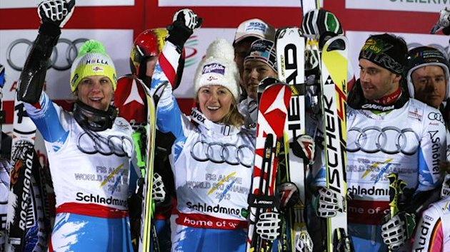 Michaela Kirchgasser of Austria (C) and team mates celebrate their first place finish on the podium during the flower ceremony after the national team event at the World Alpine Skiing Championships in Schladming February 12, 2013. REUTERS