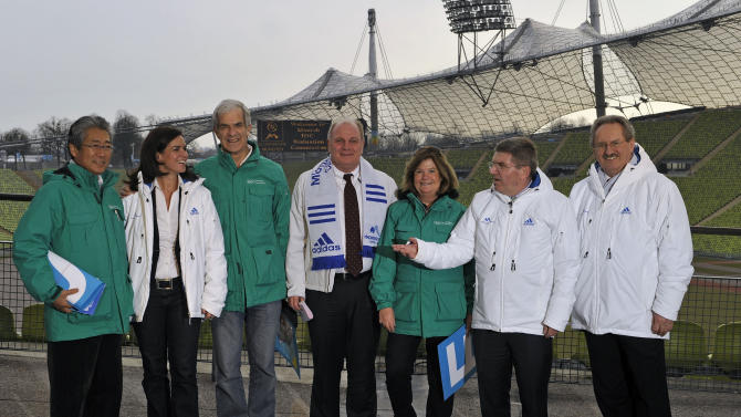 Katarina Witt, former German figure skating great, second left, Gunilla Lindberg, chair of IOC Evaluation Commission, third right, Christian Ude the mayor of Munich, right, Ulli Hoeness, president of FC Bayern Munich, center and Thomas Bach, a German vice president of the IOC and president of the national Olympic body, second right, pose with two unidentified members of the commission at the Olympic Stadium in Munich southern Germany, on Thursday, March 3, 2011. Munich is seeking to become the first city to stage both summer and winter games and plans call for much of the 1972 Olympic park to be used in 2018 should the Bavarian capital win the bid. (AP Photo/dapd, Joerg Koch)