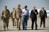 U.S. Defense Secretary Leon Panetta (C) speaks with U.S. Ambassador to Afghanistan Ryan Crocker (2nd R) and General John Allen (front 2nd L), head of the NATO coalition forces in Afghanistan, upon his arrival at Kabul International Airport June 7, 2012. REUTERS/Jim Watson/Pool