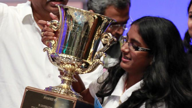 "Snigdha Nandipati, 14, of San Diego, holds the trophy after winning the National Spelling Bee with the word ""guetapens"" Thursday, May 31, 2012 in Oxon Hill, Md. (AP Photo/Alex Brandon)"