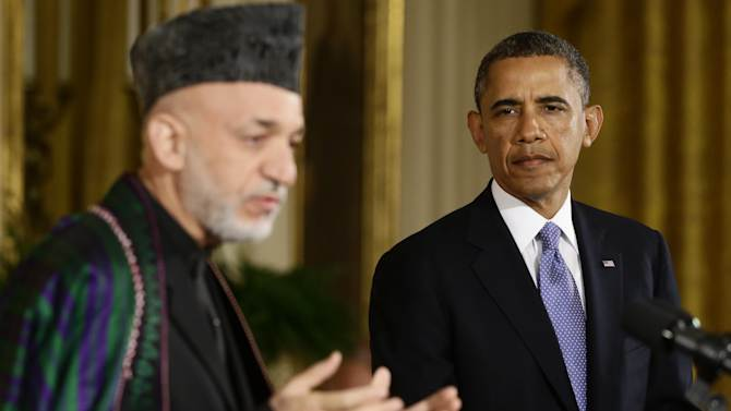 President Barack Obama listens as Afgan President Hamid Karzai speaks during their joint news conference in the East Room at the White House in Washington, Friday, Jan. 11, 2013. (AP Photo/Charles Dharapak)