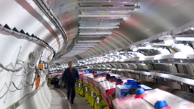 In this 2005 photo provided by CERN, the European Organization for Nuclear Research, technicians check the magnets that will direct protons towards the target for the CERN Neutrinos to Gran Sasso (CNGS) project in Geneva. The project team, a collaboration between France's National Institute for Nuclear and Particle Physics Research and Italy's Gran Sasso National Laboratory, fired a neutrino beam 454 miles (730 kilometers) underground from Geneva to Italy. They found it traveled 60 nanoseconds faster than light. That's sixty billionth of a second, a time no human brain could register. Physicists on the team said Friday Sept. 23, 2011 they were as surprised as their skeptics about the results, which appear to violate the laws of nature as we know them. (AP Photo/CERN)