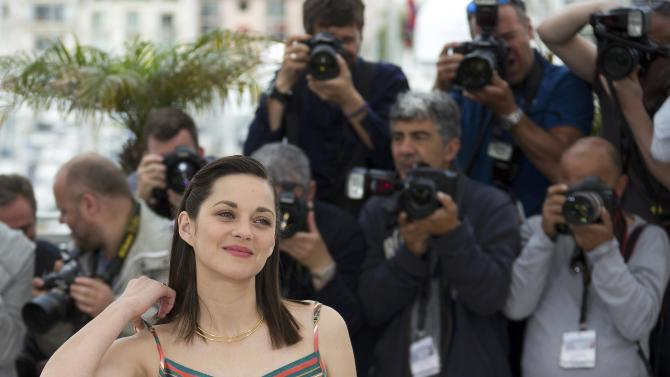 """Cast member Marion Cotillard poses during a photocall for the film """"Macbeth"""" in competition at the 68th Cannes Film Festival in Cannes"""