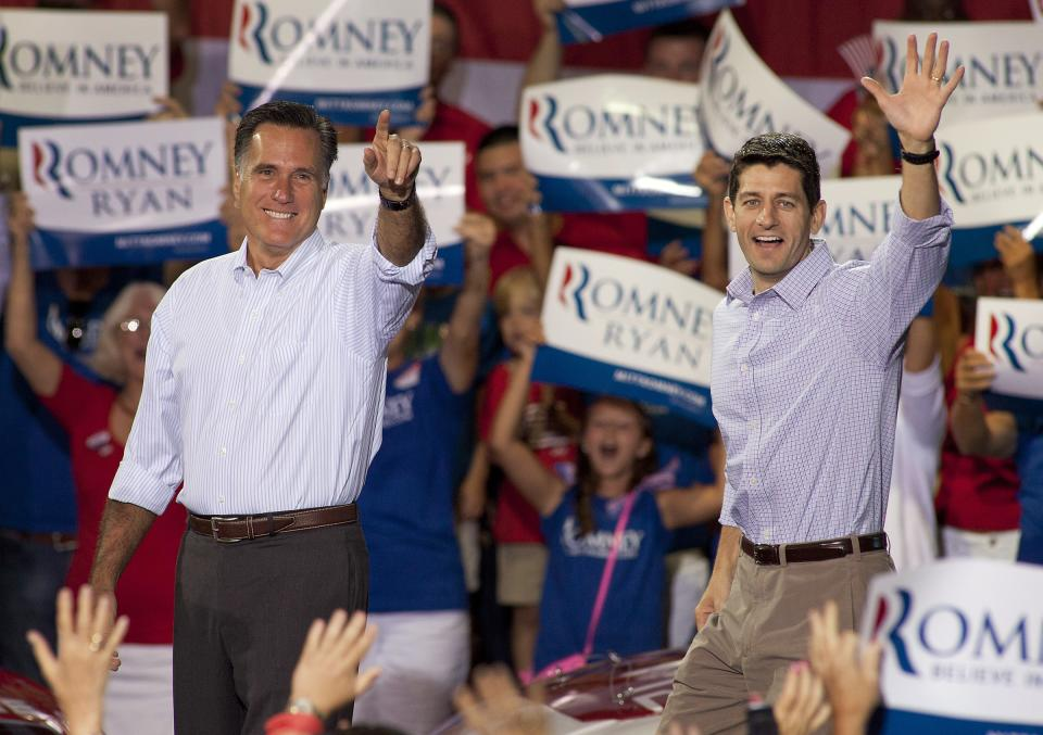 Republican presidential candidate Mitt Romney, left, and his vice presidential running mate Rep. Paul Ryan, R-Wis., arrive at a campaign rally Sunday, Aug. 12, 2012 in Mooresville, N.C., at the NASCAR Technical Institute. (AP Photo/Jason E. Miczek)