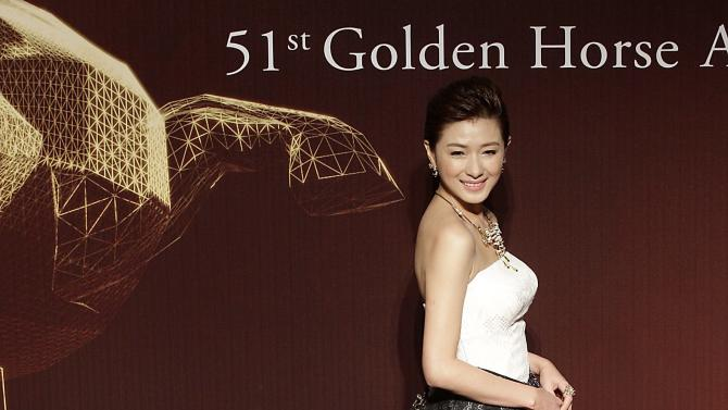 Chinese actress Wan Qian poses for photographers on the red carpet at the 51st Golden Horse Film Awards in Taipei