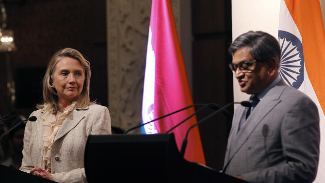 U.S. Secretary of State Hillary Rodham Clinton, left, listens to India's Foreign Minister S.M. Krishna during a news conference in New Delhi, India Tuesday, May 8, 2012. (AP Photo/Shannon Stapleton, Pool)