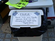 Occupy OKC brought their own trash receptacles to the park, posting signs such as this to let campers know where to dispose of refuse.