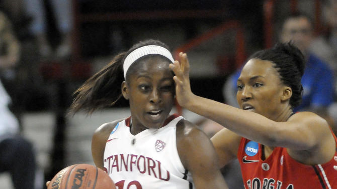 Georgia's Tamika Willis (23) gets hand in the face of Stanford's Merritt Hempe (13) during the first half of a regional semifinal in the NCAA women's college basketball tournament, Saturday, March 30, 2013, in Spokane, Wash. (AP Photo/Jed Conklin)