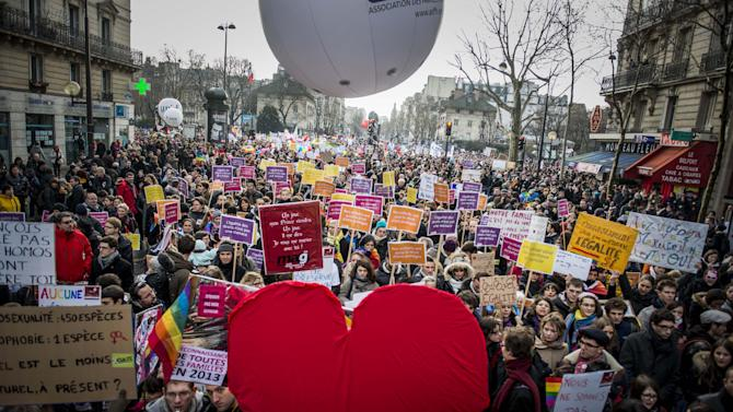 People demonstrate in support of a government project to legalize same-sex marriage and adoption for same-sex couples in Paris, France, Sunday, Jan. 27, 2013. (AP Photo/Benjamin Girette)