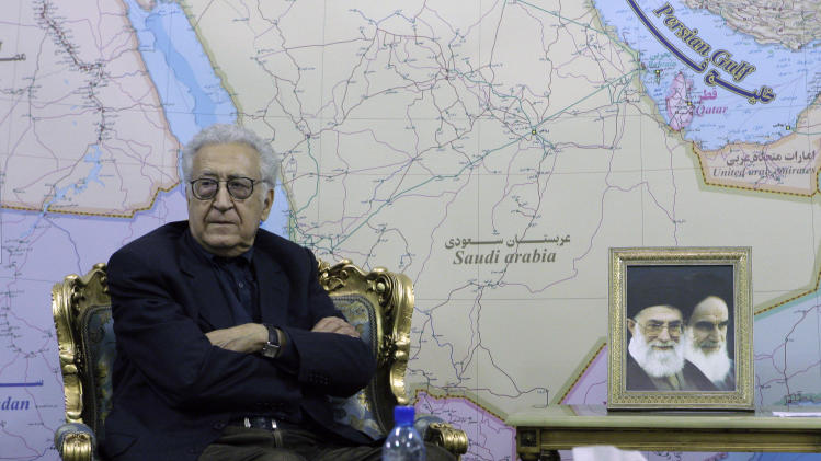 U.N. envoy on Syria, Lakhdar Brahimi, sits,  next to portraits of late Iranian revolutionary founder Ayatollah Khomeini, right, and supreme leader Ayatollah Ali Khamenei, during his meeting with Iranian Foreign Minister Ali Akbar Salehi, unseen, in Tehran, Iran, Sunday, Oct. 14, 2012. (AP Photo/Vahid Salemi)
