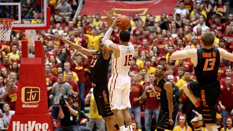 Iowa State guard Naz Long puts up a 3-pointer over Oklahoma State guard/forward Leyton Hammonds right before the buzzer in the second half of an NCAA college basketball game to send it to overtime in Ames, Iowa, Saturday, March 8, 2014. Iowa State won 85-81 in overtime. (AP Photo/Justin Hayworth)