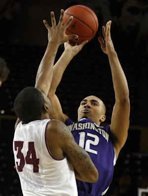 Huskies rout Sun Devils 76-65 to open Pac-12