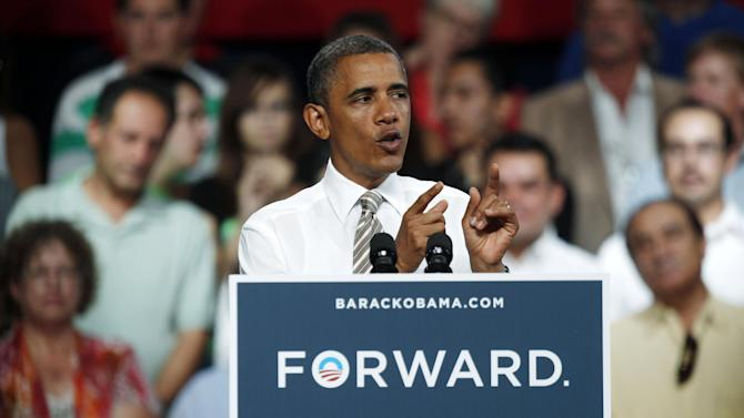 President Barack Obama speaks during a campaign stop at the Colorado State Fairgrounds in Pueblo, Colo., Thursday Aug. 9, 2012.  (AP Photo/David Zalubowski)