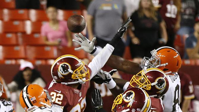 Washington Redskins defensive back Da'Mon Cromartie-Smith (32) and cornerback Richard Crawford (20) defend as Cleveland Browns tight end Emmanuel Ogbuehi, right, catches a touchdown pass at the end of the second half of an NFL preseason football game Monday, Aug. 18, 2014, in Landover, Md