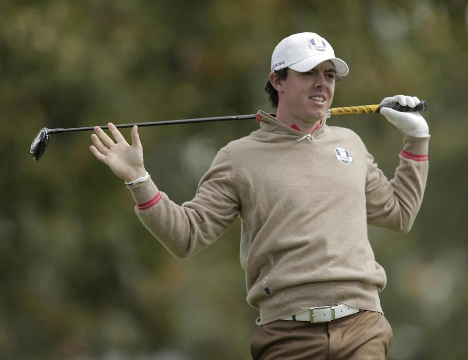 Europe's Rory McIlroy watches his drive on the 15th hole during a practice round at the Ryder Cup PGA golf tournament Thursday, Sept. 27, 2012, at the Medinah Country Club in Medinah, Ill. (AP Photo/Charlie Riedel)