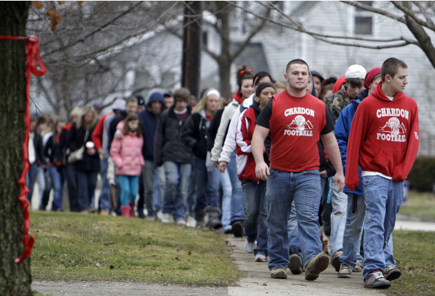 Hundreds of students and parents march to Chardon High School in Chardon, Ohio, Thursday, March 1, 2012, to honor the three students who were killed in a shooting there Monday. The school re-opened to