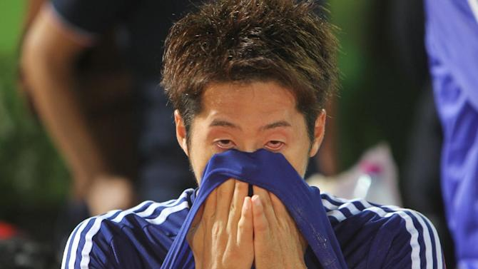 Japan's Oba Takaaki reacts after losing the final match against Oman during the AFC Beach Soccer Championship final football match between Japan and Oman in Doha, Qatar, Saturday, March 28, 2015. (AP Photo/Osama Faisal)