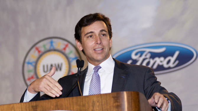 FILE - In this June 13, 2012 file photo, Mark Fields, Ford president of The Americas, speaks to workers and media at the Louisville Assembly Plant in Louisville, Ky. Ford Motor Co.'s board of directors is meeting Thursday, Sept. 13, 2012, and CEO succession could be on the agenda. Bloomberg reported Tuesday that the directors are close to promoting Fields to chief operating officer. The report quoted an unnamed source. (AP Photo/Brian Bohannon, File)