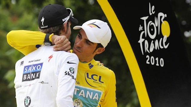 Astana team rider and leader's yellow jersey Alberto Contador of Spain (R) is congratulated by Saxo Bank team rider Andy Schleck of Luxembourg on the podium in Paris after the final 20th stage of the 97th Tour de France cycling race between Longjumeau and