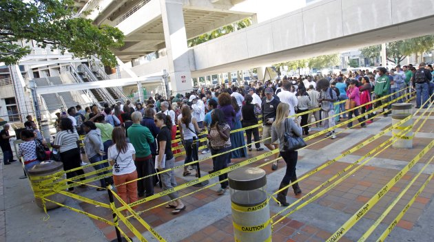 South Floridians stand in line during the last day of early voting in Miami, Saturday, Nov. 3, 2012. Despite record turnout in many parts of the state, Florida Gov. Rick Scott rejected calls to extend early voting through Sunday to help alleviate long lines at the polls. (AP Photo/Alan Diaz)