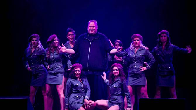"""Indicted Megaupload founder Kim Dotcom, center, poses with women during the launch of a new file-sharing website called """"Mega"""" at his Coatesville mansion in Auckland, New Zealand, Sunday, Jan. 20, 2013. The colorful entrepreneur unveiled the site ahead of a lavish gala and press conference on the one-year anniversary of his arrest on racketeering charges related to his now-shuttered Megaupload file-sharing site. (AP Photo/New Zealand Herald, Richard Robinson) NEW ZEALAND OUT, AUSTRALIA OUT"""