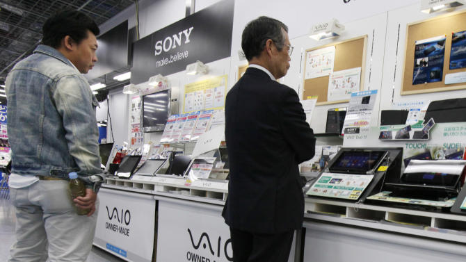 Shoppers look at a Sony's product at a  electronics store in Tokyo,Thursday, May 9, 2013. Sony Corp. is back in the black for the fiscal fourth quarter, recording a 93.9 billion yen ($948 million) profit, with big help from a weaker yen that boosts overseas earnings.  (AP Photo/Koji Sasahara)