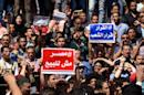 Egyptian protesters with placards shout slogans during a demonstration against a controversial deal to hand two islands in the Red Sea to Saudi Arabia on April 15, 2016 in central Cairo