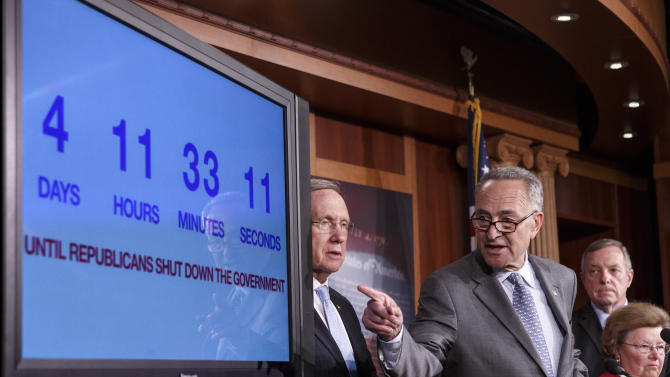 With four days to go before the federal government is due to run out of money, Sen. Charles Schumer, D-N.Y., center, points to a countdown clock during a news conference on Capitol Hill in Washington, Thursday, Sept. 26, 2013, as Senate Democratic leaders blame conservative Republicans for holding up a stopgap spending bill to keep the government running. From left are, Senate Majority Leader Harry Reid of Nev., Schumer, Senate Majority Whip Richard Durbin of Ill., and Senate Appropriations Committee Chair Sen. Barbara Mikulski, D-Md. (AP Photo/J. Scott Applewhite)