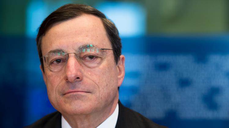 European Central Bank President Mario Draghi addresses the committee on economic and monetary affairs at the European parliament in Brussels, Wednesday April 25, 2012. (AP Photo/Geert Vanden Wijngaert)