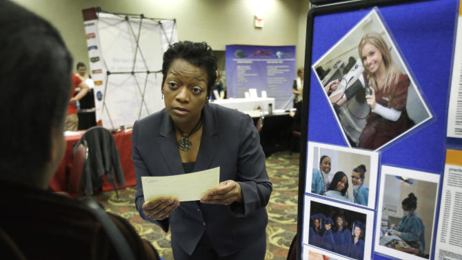 Applications for US jobless aid reach 5-year low